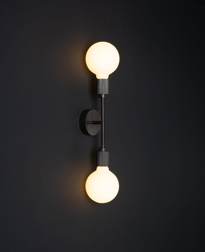 belgravia antique black lit LED wall light against black wall