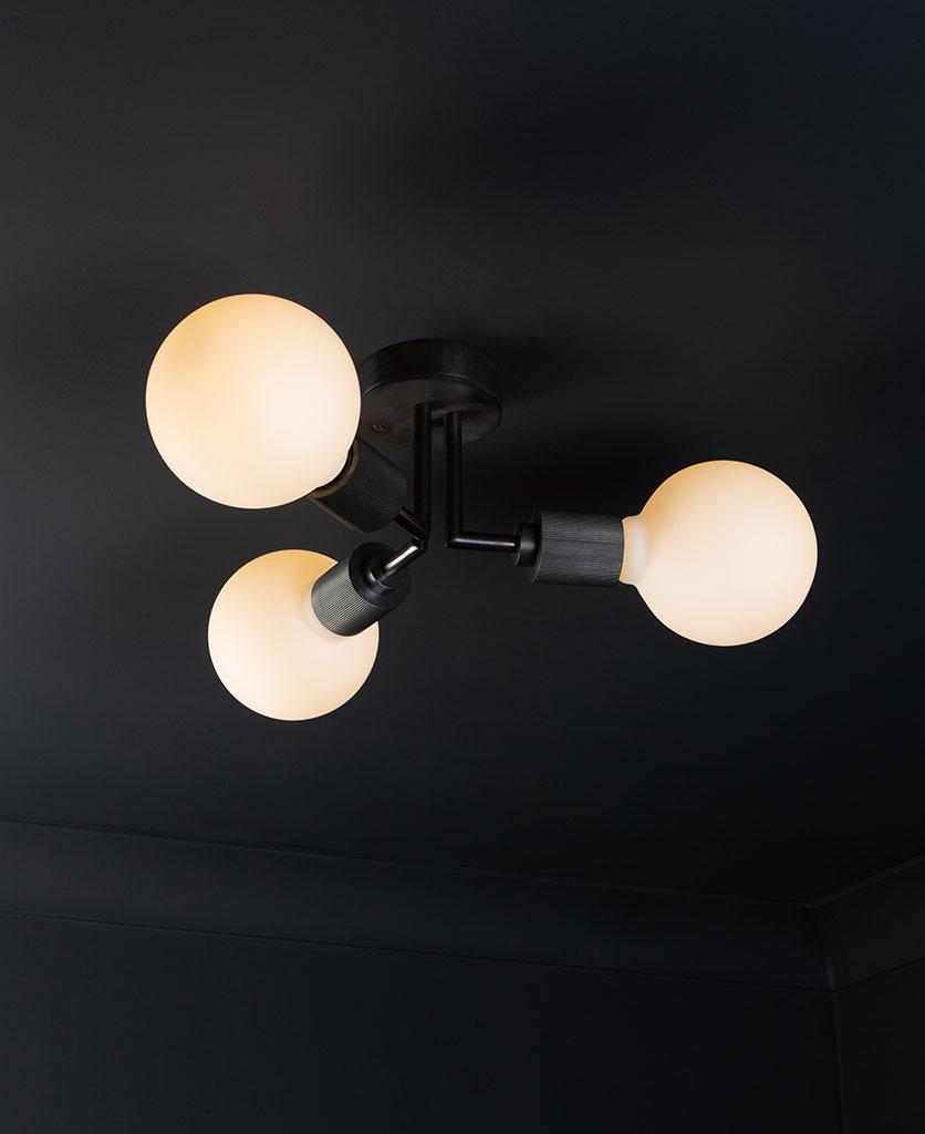 semi flush ceiling lights hoxton antique black ceiling light with 3 lit bulbs on black ceiling