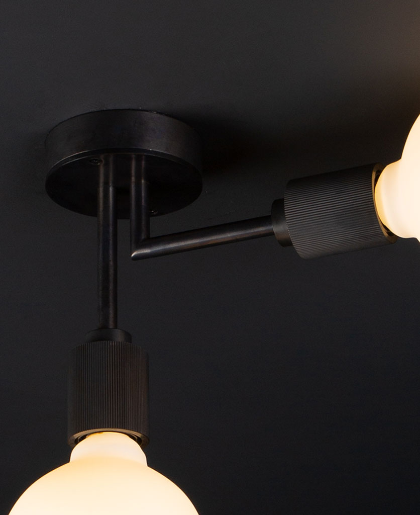 closeup of langham antique black ceiling light on