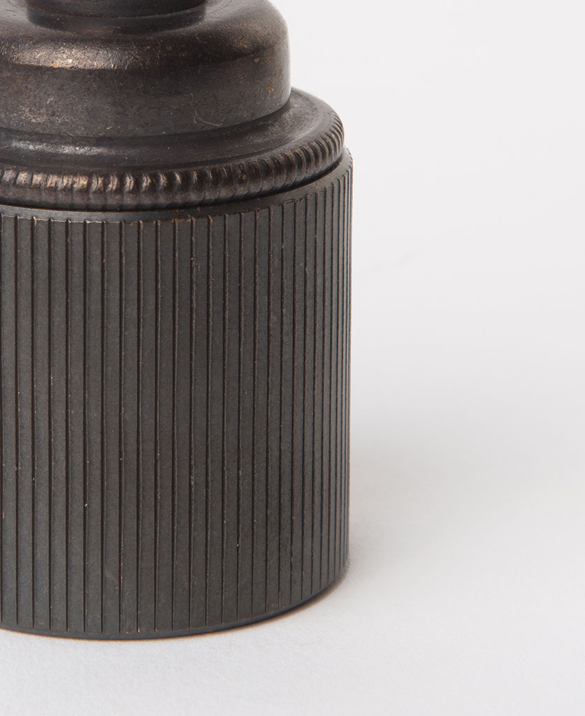closeup of antique black e27 ribbed bulb holder against white background