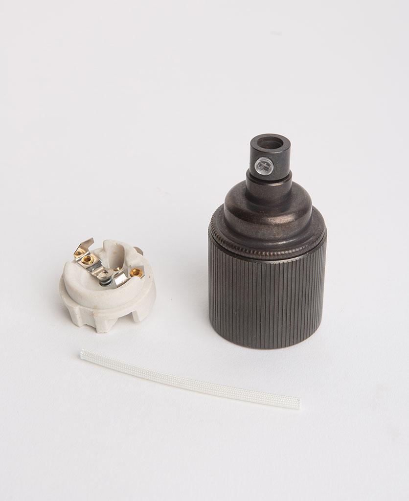 antique black e27 ribbed bulb holder with porcelain insert against white background