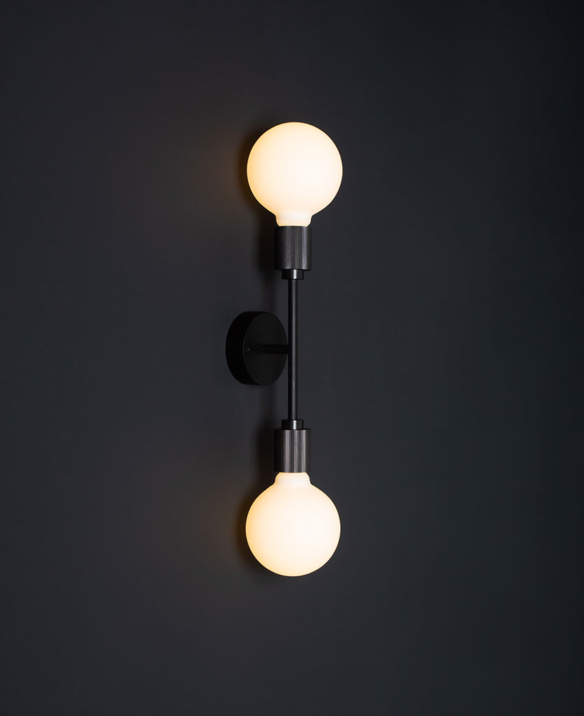 belgravia black lit LED wall light against black wall