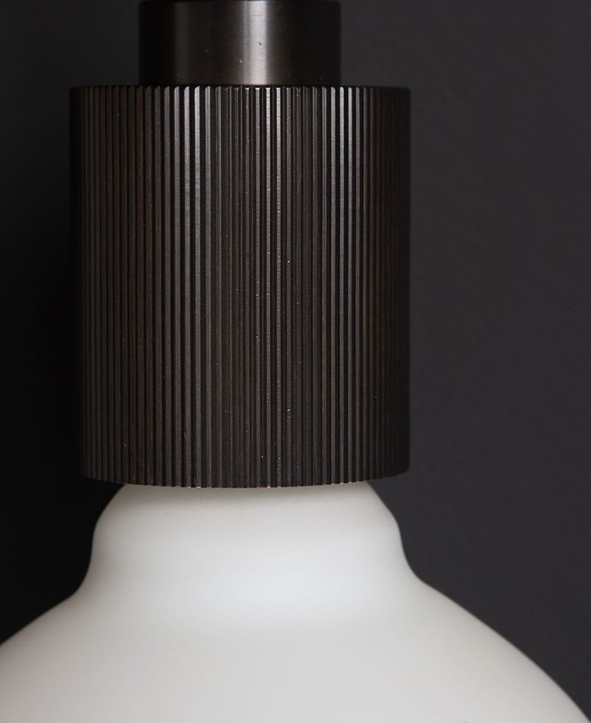 Black Ritz Wall Light against black background