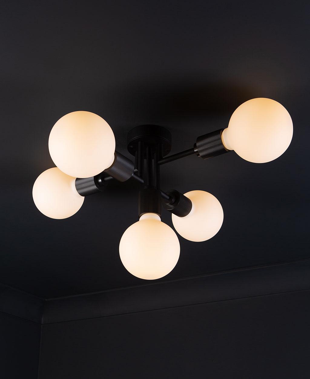 connaught flush ceiling light black ceiling light with 5 bulbs on black ceiling.