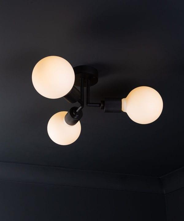 semi flush ceiling lights hoxton black ceiling light with 3 lit bulbs on black ceiling