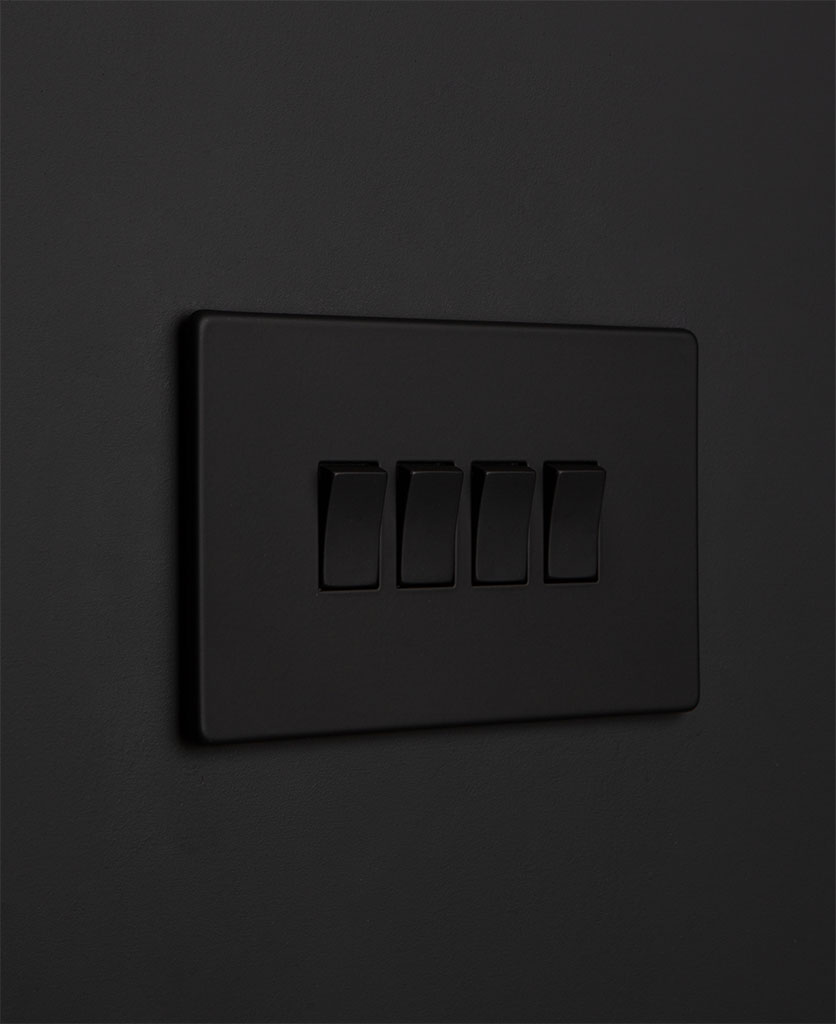 Black quadruple rocker switch with black switches