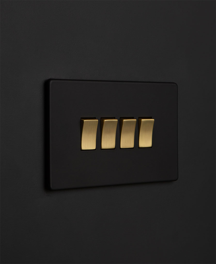 Black quadruple rocker switch with gold switches