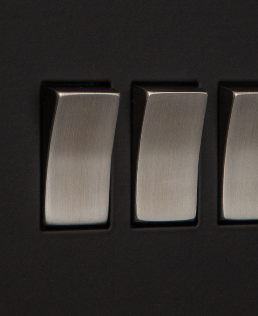 closeup of black and silver quadruple rocker switch