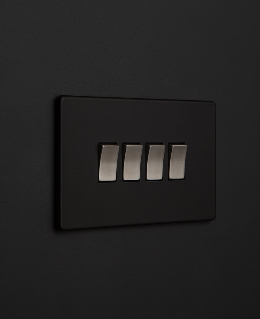 Black quadruple rocker switch with silver switches