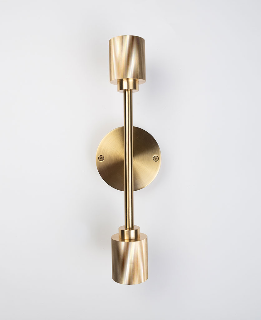 belgravia brass wall light on white background