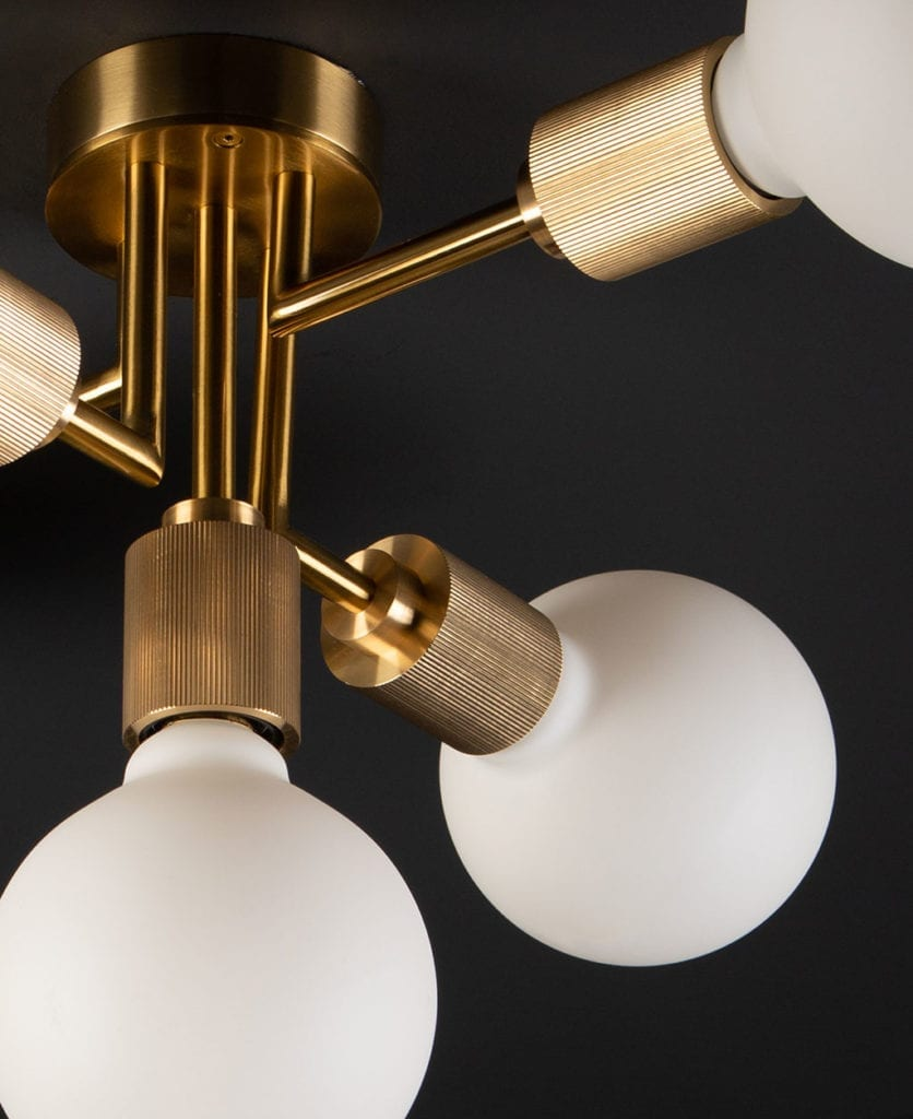 brass connaught ceiling light against black ceiling