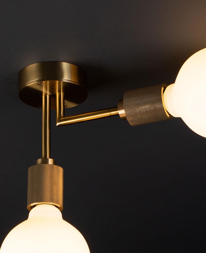 closeup of langham gold ceiling light on