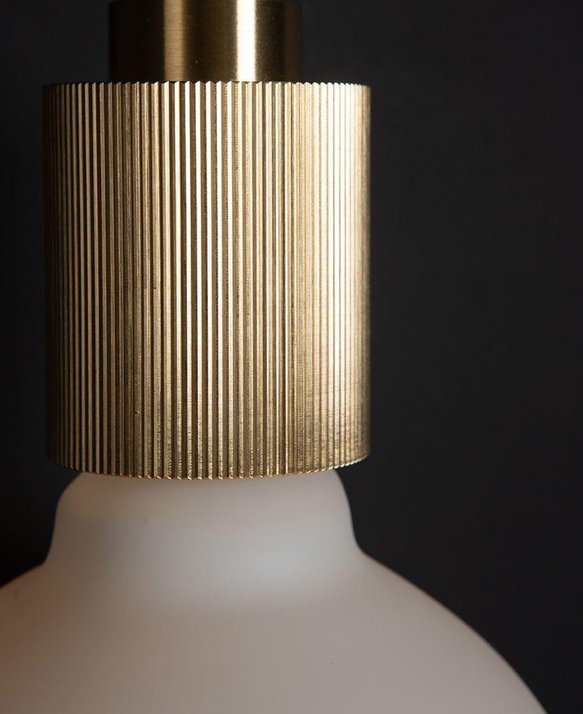 Brass Wall Light against black background