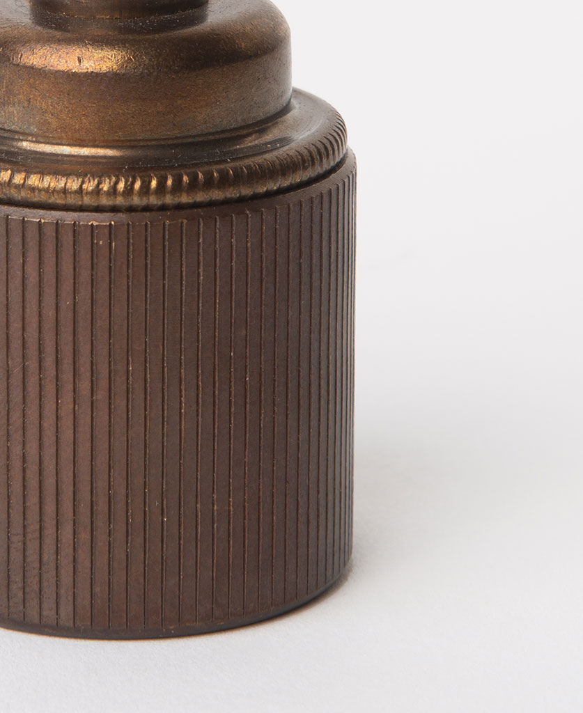 closeup of brewer's brass e27 ribbed ES lamp holder against white background