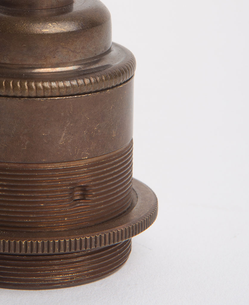 closeup of brewer's brass threaded e27 lamp holders against white background