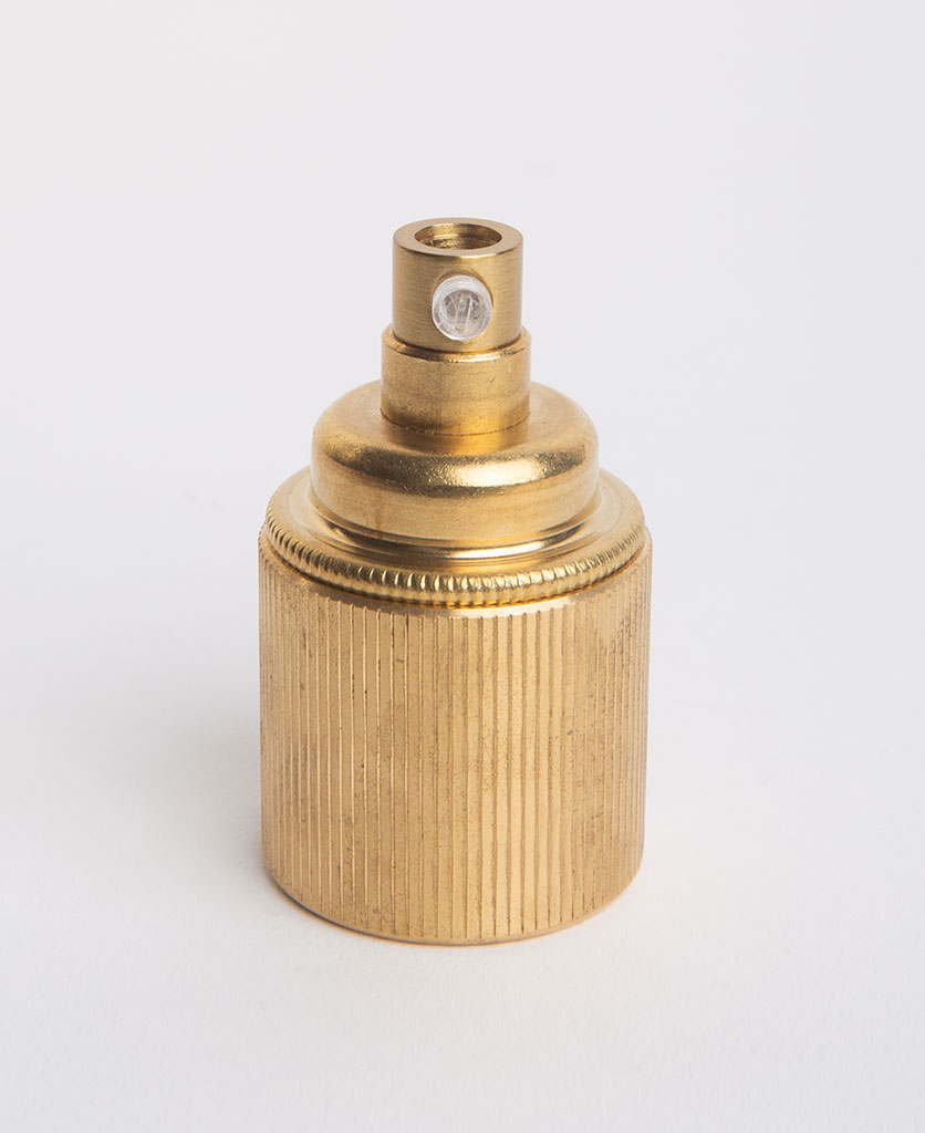 e27 raw brass lamp holderwith ribbed detail against white background