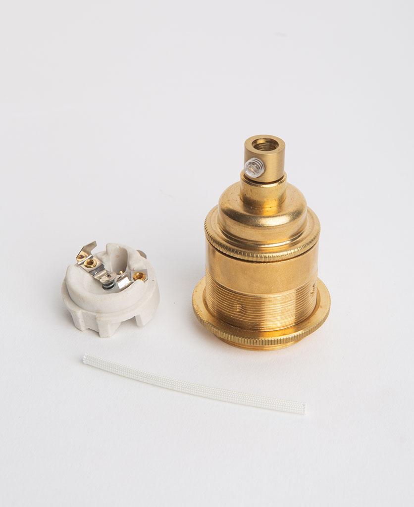 e27 threaded raw brass bulb holder with porcelain insert against white background