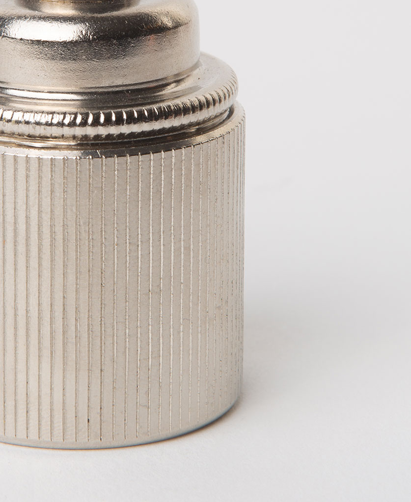 closeup of forgotten silver e27 ribbed lamp holder against white background