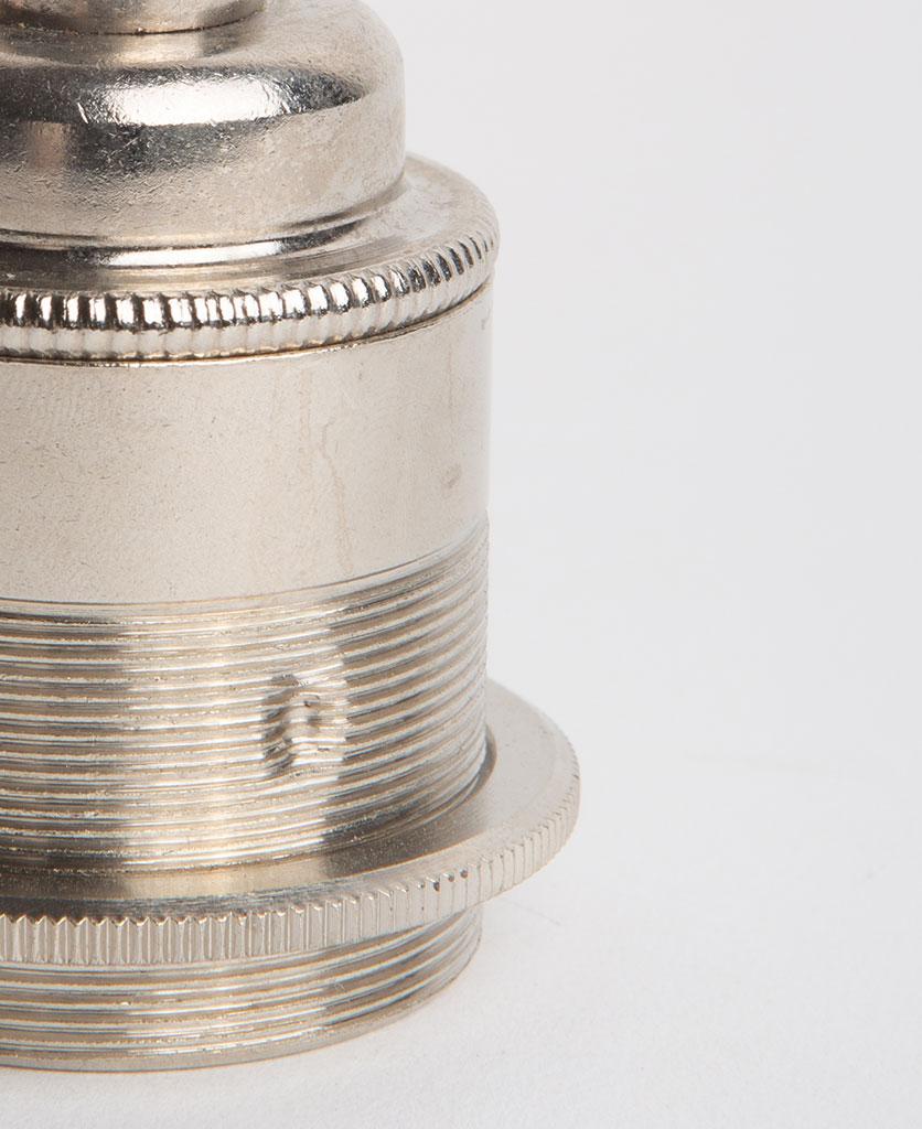 closeup of nickel threaded e27 bulb holder against white background