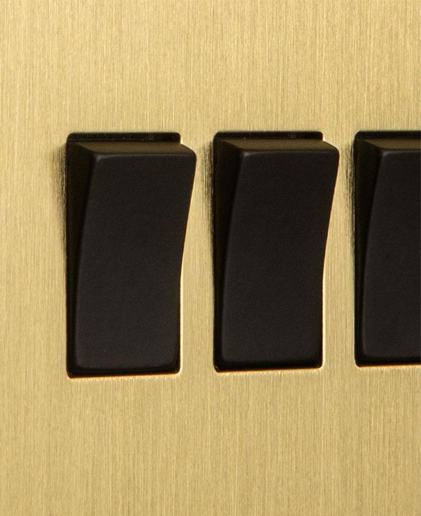 closeup of gold and black quadruple rocker switch