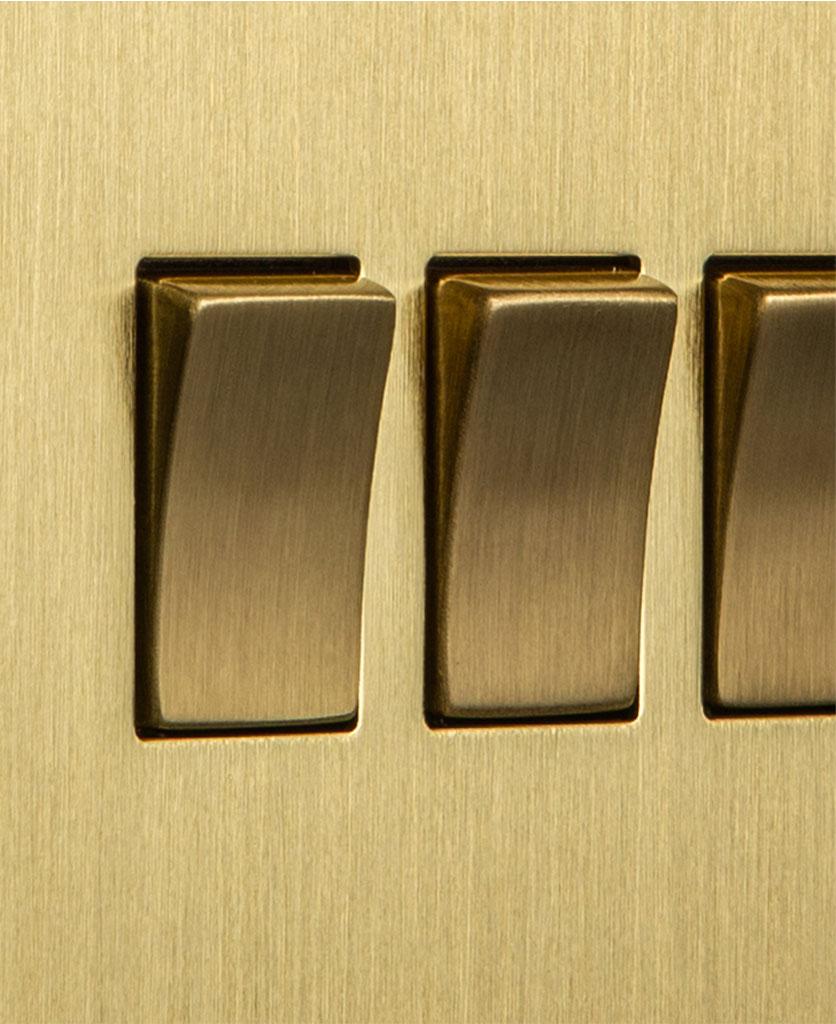 closeup of gold quadruple rocker switch