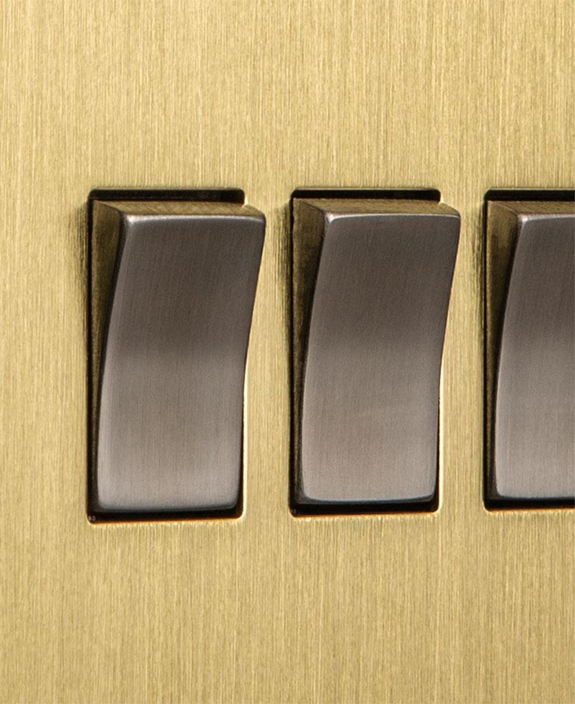 closeup of gold and silver quadruple rocker switch