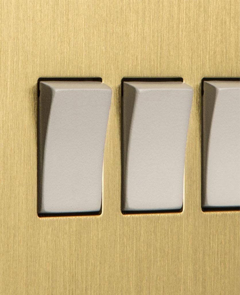closeup of gold and white quadruple rocker switch