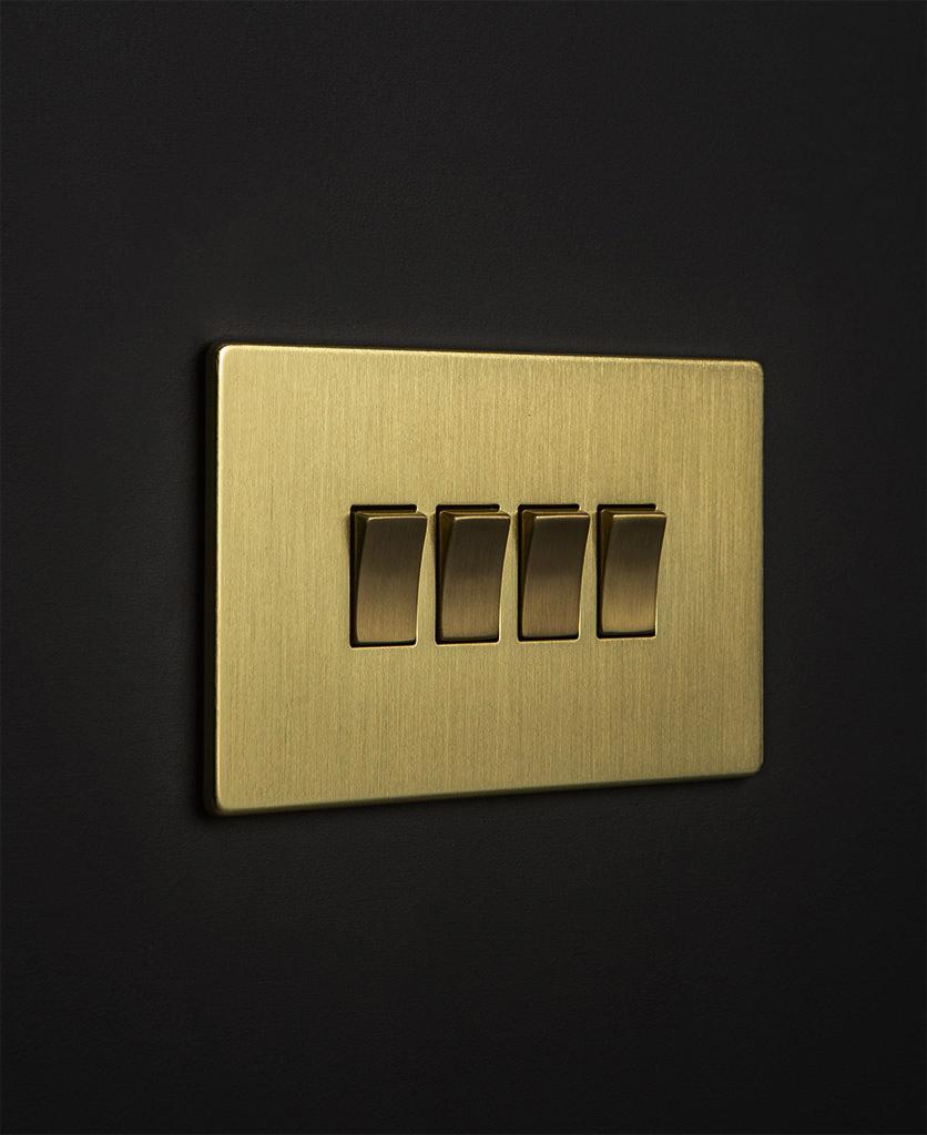 gold & gold quad rocker against black wall