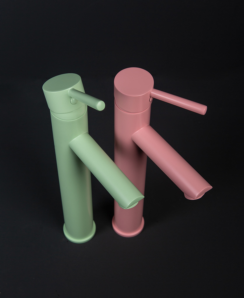 Inga mint green and miami pink bathroom mixer taps side by side on black background