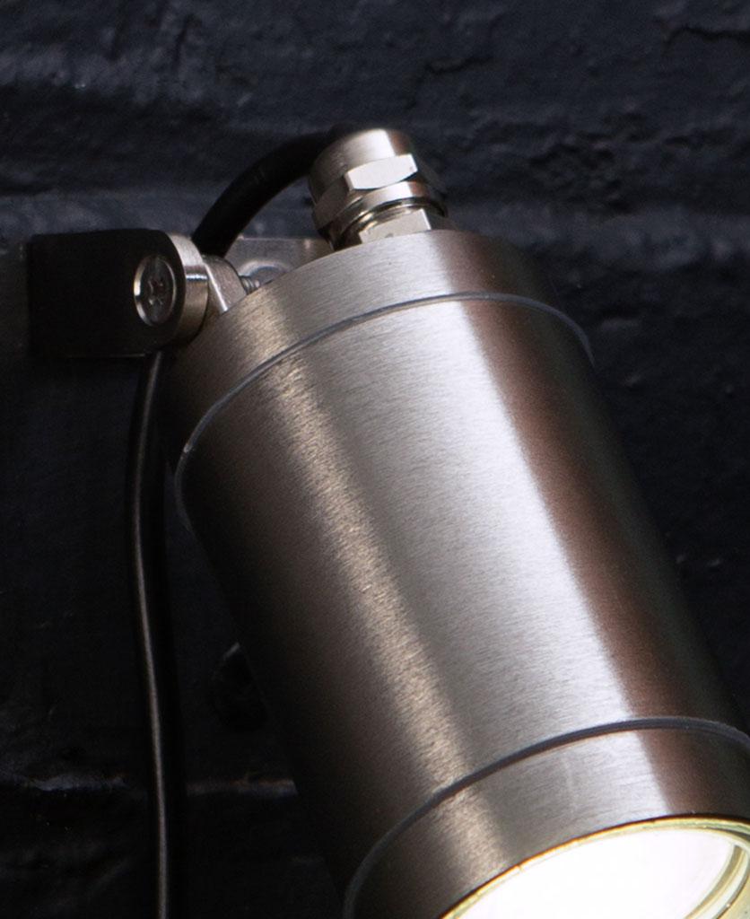 silver leonis led outside light closeup on black painted brick wall