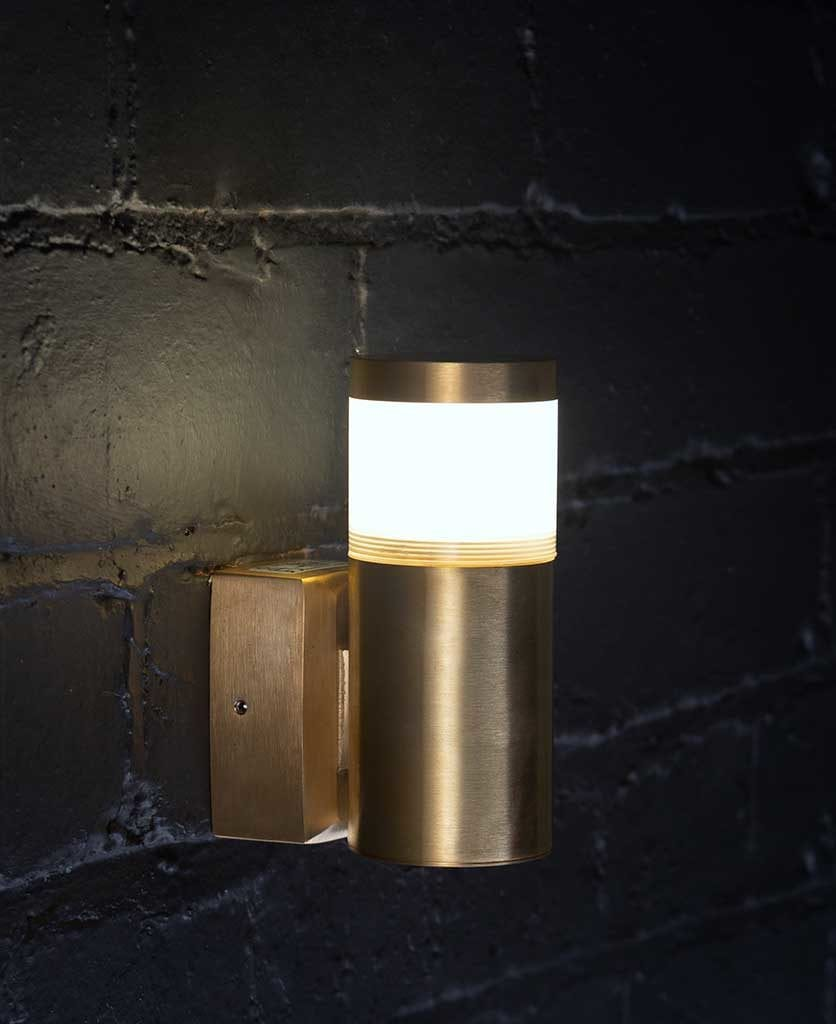 pegasi brass outside light on black painted brick wall