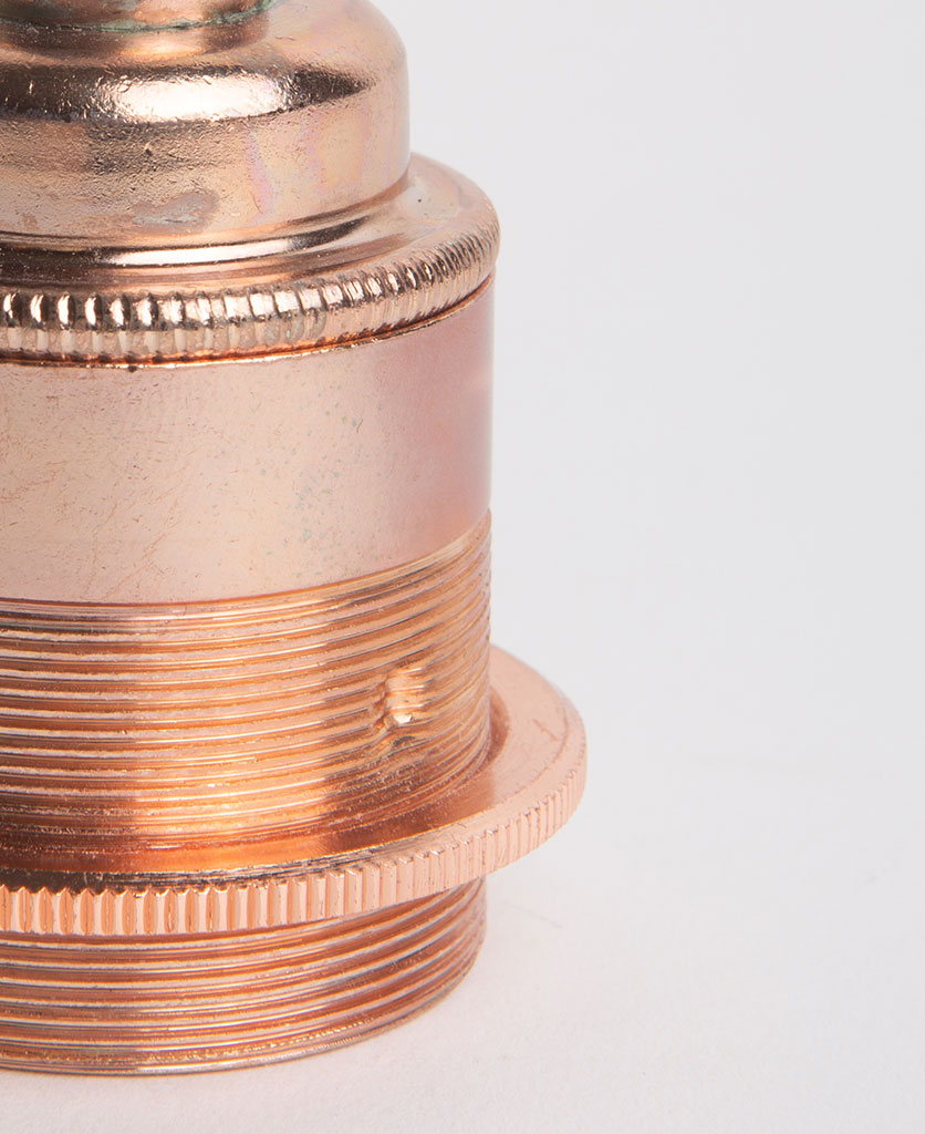 closeup of polished copper threaded e27 bulb holders against white background