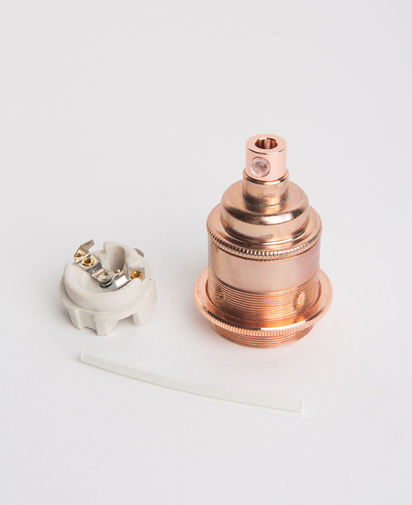 polished copper threaded e27 bulb holders with porcelain insert against white background