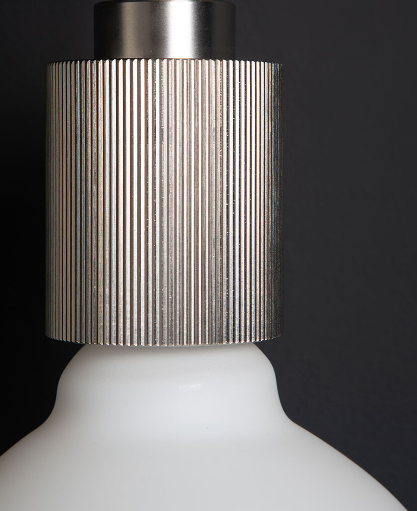 closeup of silver ribbed bulbholder