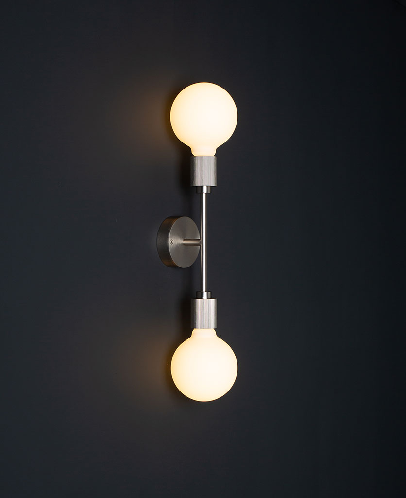 belgravia silver lit LED wall light against black wall