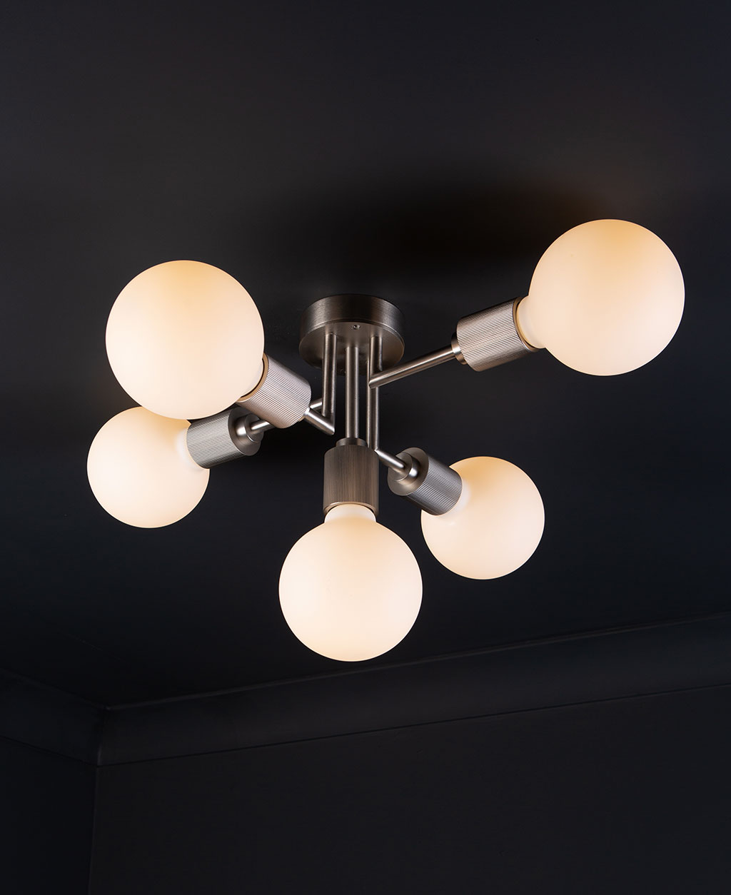 connaught flush ceiling light silver ceiling light with 5 bulbs on black ceiling.