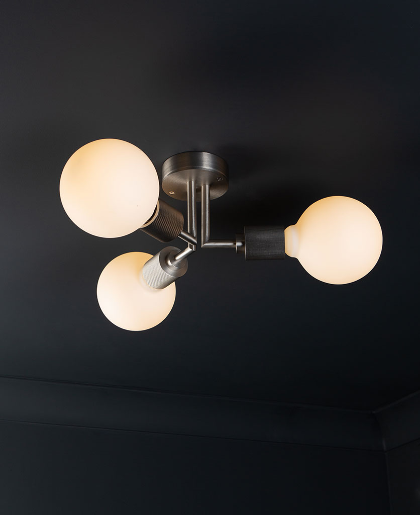 semi flush ceiling lights hoxton antique silver ceiling light with 3 lit bulbs on black ceiling
