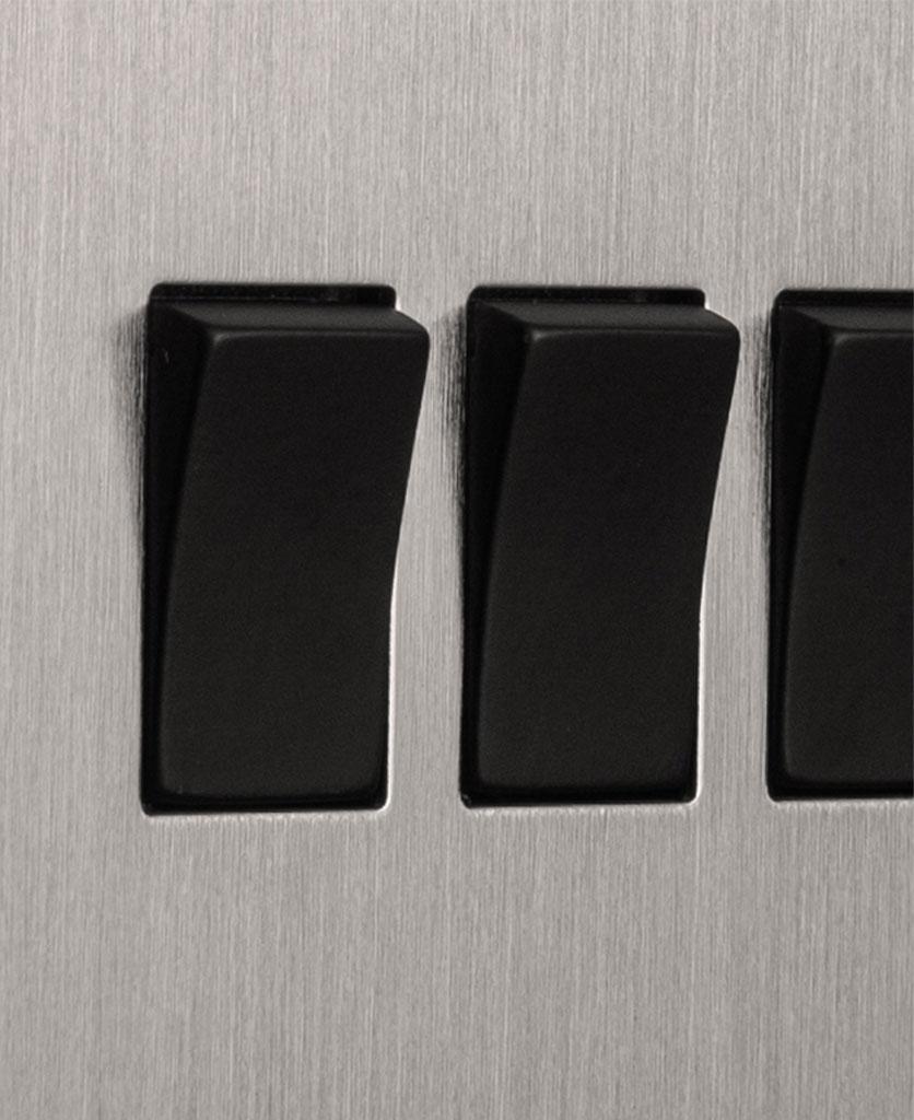 closeup of silver and black quadruple rocker switch