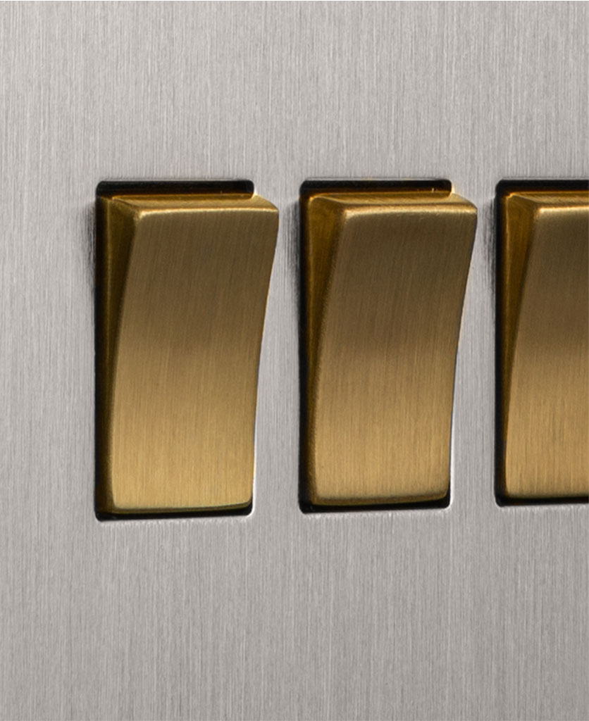closeup of silver and gold quadruple rocker switch