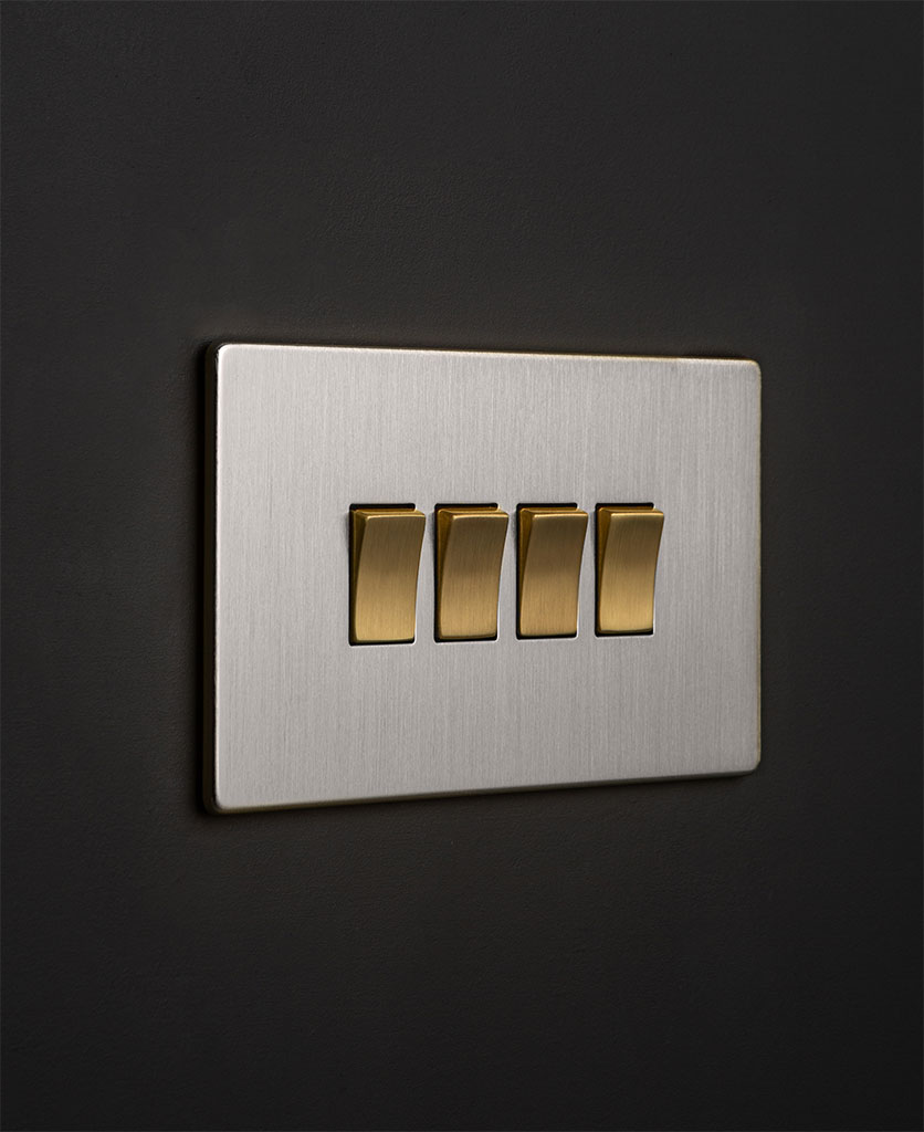 silver 4g switcher with quadruple gold rocker detail on a black wall