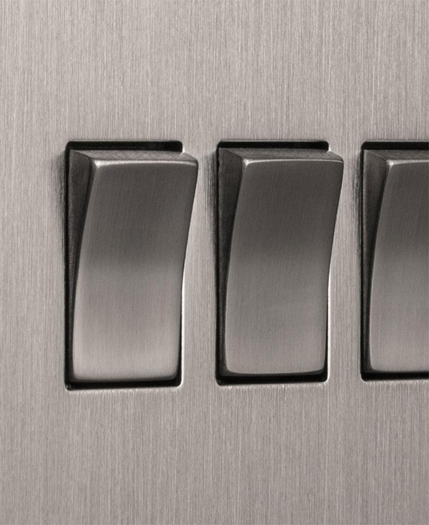closeup of silver quadruple rocker switch