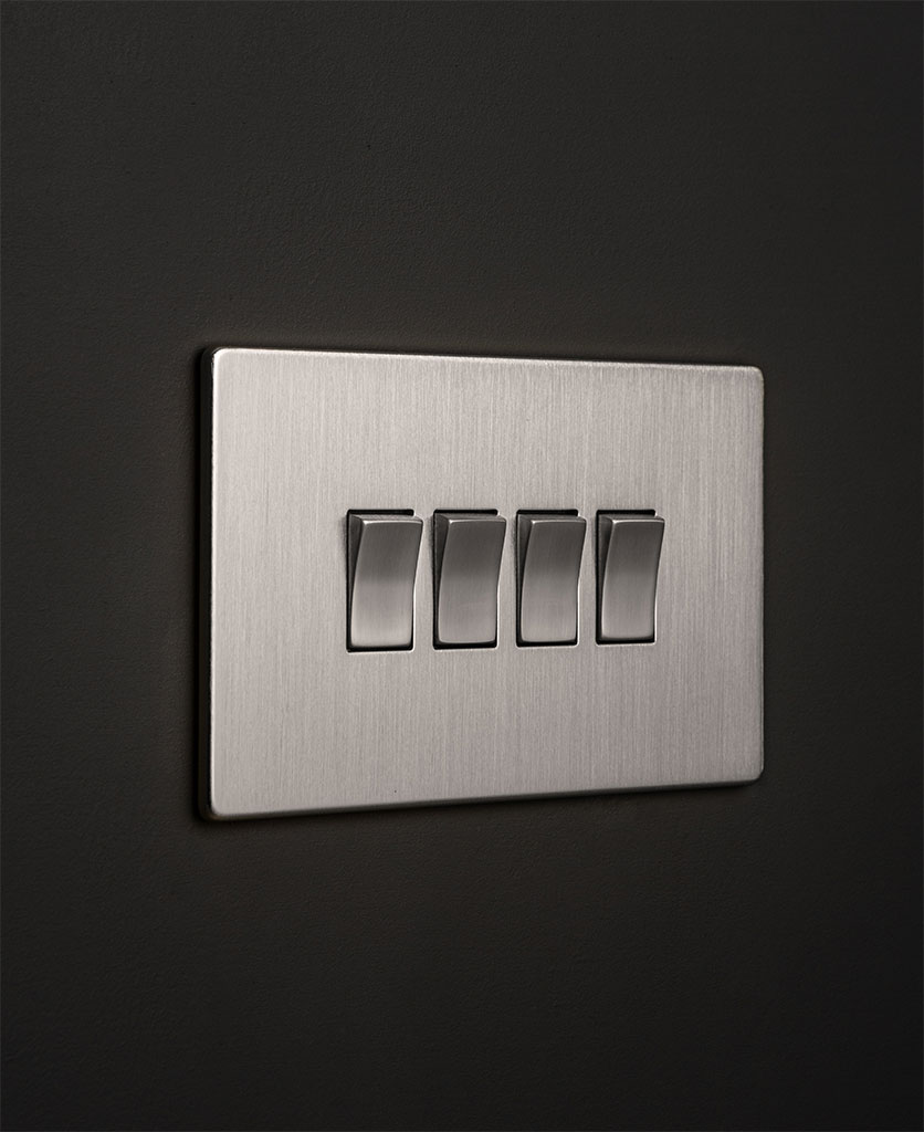 silver 4g switcher with quadruple silver rocker detail on a black wall