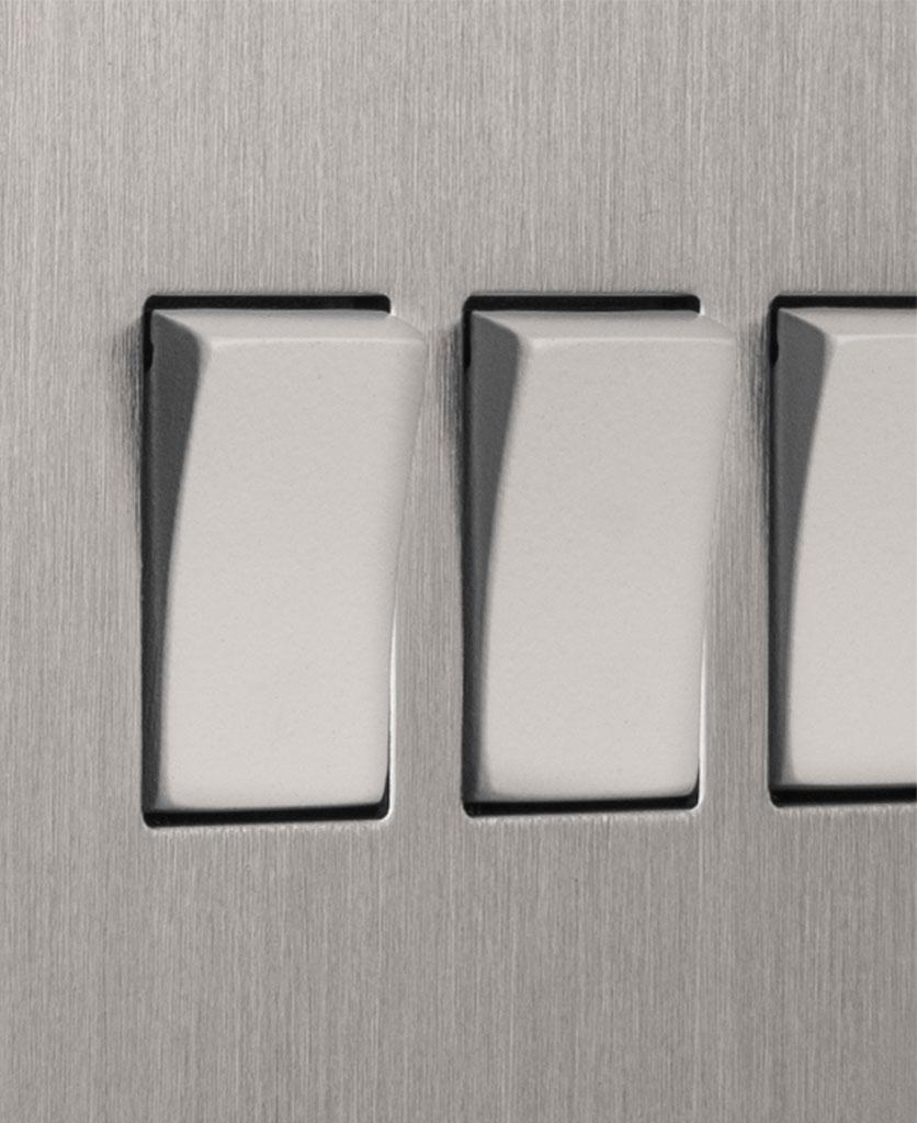 closeup of silver and white quadruple rocker switch