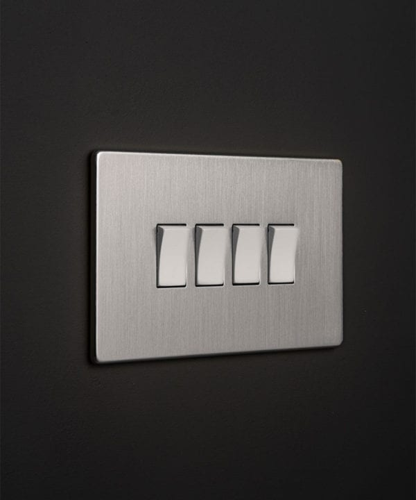 silver 4g switcher with quadruple white rocker detail on a black wall