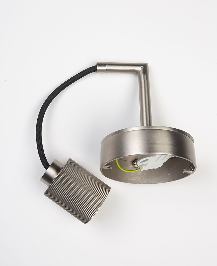 silver ritz wall light laid on white background
