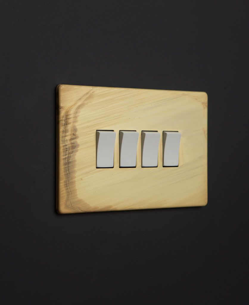 smoked gold on off rocker switch with white rocker detailing on black wall