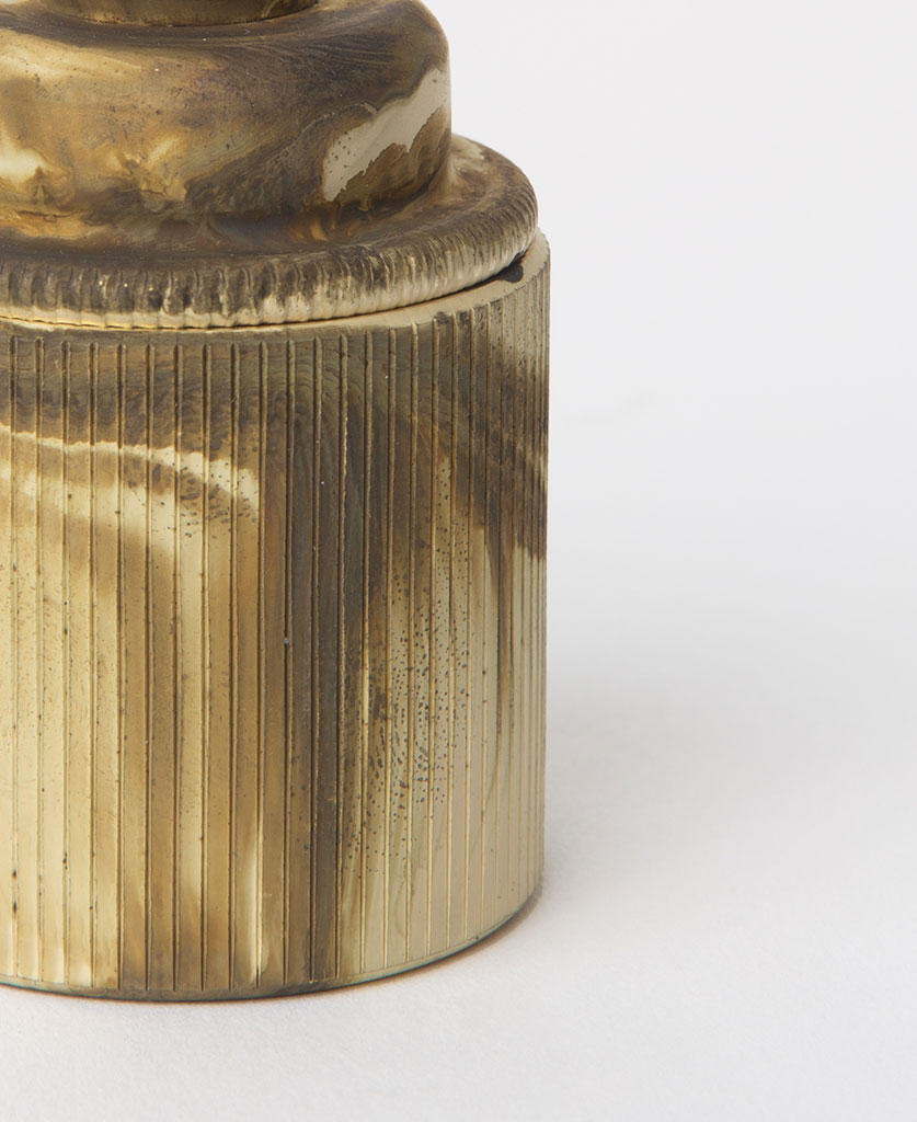 closeup of smoked gold e27 holder with ribbed detail against white background