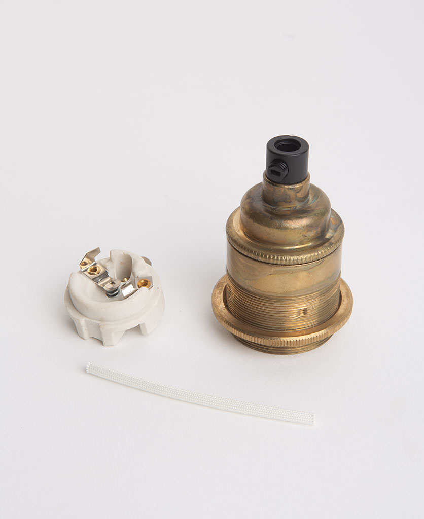 smoked gold threaded lamp holder with porcelain inserts against white background