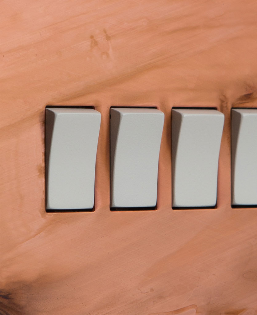 copper quadruple rocker switch with white switch