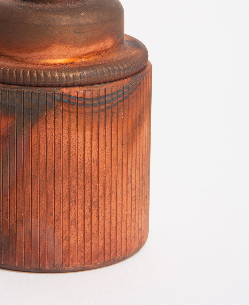 closeup tarnished copper edison screw lamp holder against white background